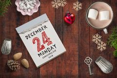 Tear-off calendar with 24th of december 2018 on top. On a wooden surface royalty free stock images