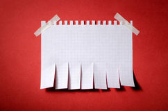 Tear off paper notice. On the wall Royalty Free Stock Image