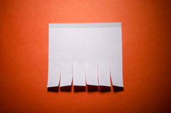 Tear off paper on the wall. Tear off paper notice on the wall Stock Image