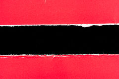 Tear red paper pieces of paper on black Royalty Free Stock Photography