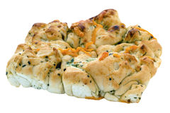 Tear and Share Bread with Cheese and Garlic. Tear and share bread with cheese, garlic and herbs on an isolated white background with a clipping path Stock Photo