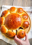Tear and share loaf with raisin. On board Royalty Free Stock Image
