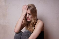 Tear-stained young woman Stock Photo