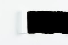 Tear white paper pieces of paper on black. Background Royalty Free Stock Photos