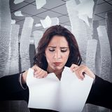 Tear a worksheet. Woman nervous and stressed tears a worksheet Royalty Free Stock Photos