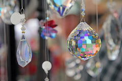 Teardrop crystal with multi color prism. Hanging teardrop crystal ball with multi color prisms Stock Image