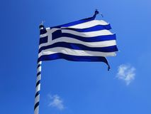 Teared up greek flag Royalty Free Stock Image