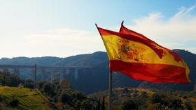 Teared up Spanish flag waving in slow motion stock footage