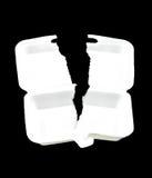 Teared White styrofoam box on black background Royalty Free Stock Images