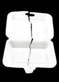 Teared White styrofoam box on black background Royalty Free Stock Photos