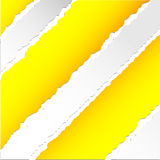 Teared yellow pattern paper Stock Image