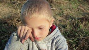Tearful boy stock video