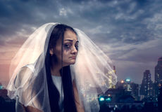 Tearful bride on the background of night city Stock Photos