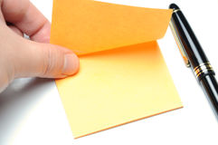 Tearing adhesive note Stock Images