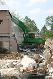 Tearing Down The House. Medium weight shovel tearing down a building in preparation for construction stock image