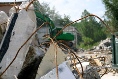 Tearing Down The House. Medium weight shovel tearing down a building in preparation for construction Stock Photography
