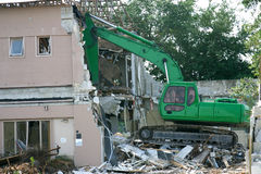 Tearing Down The House. Heavy shovel tearing down a building in preparation for construction Stock Photography