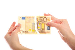 Tearing fifty-euro note Stock Photo