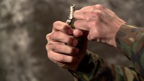 Tearing off a Grenade Ring Close Up stock video