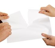 Tearing sheet of paper strongly stock image