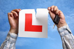 Tearing up L plate after passing driving test Royalty Free Stock Photography