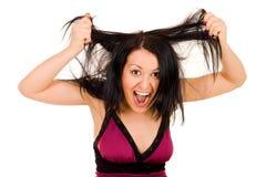 Tearing vrouw haar haren Stock Foto