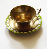 Tearoom. Metallic tearoom a chalice with saucer Royalty Free Stock Images