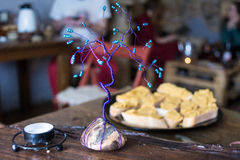 Tearoom decoration. A decorative tree on the table with sandwiches in a tea room Royalty Free Stock Photography