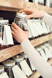 Tearoom. Woman chooses a drink while shopping in a store tea Royalty Free Stock Photography
