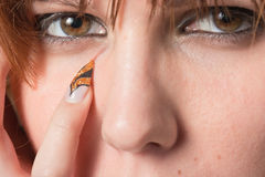 Without tears. Acute nail near the eye Royalty Free Stock Image