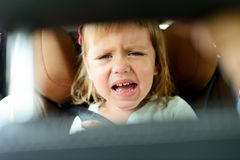Tears in car. Toddler girl crying in car Royalty Free Stock Photos