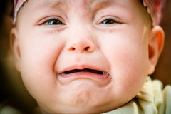 Tears - crying baby. Baby crying - pure authentic emotion, tears visible Stock Photography