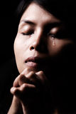 Tears in praying royalty free stock photos