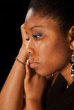 Tears of a woman. Tears running of the face of a young african woman Stock Photo