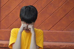 Teary Boy. Young boy rubbing eyes as he is upset about having his feelings hurt Royalty Free Stock Images
