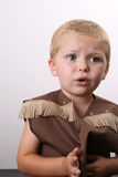 Teary Cowboy. Toddler wearing a cowboy shirt with brown fringing Stock Image