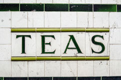 Teas ceramic sign. Tiled sign for Teas outside a disused cafe in London, UK Royalty Free Stock Photography