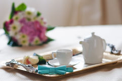 Teaset on breakfast tray in bedroom Royalty Free Stock Images