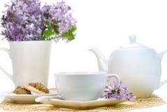 Teaset et fleurs Photo stock