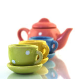 Teaset toy. Child's teaset toy on white background, on the glass Stock Photography