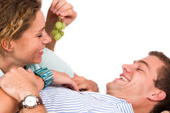 Teasing with grapes Stock Image