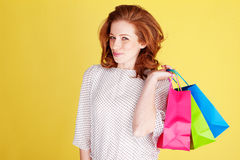 Teasing Woman With Colourful Bags Royalty Free Stock Photos