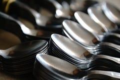 Teaspoon arranged symmetrically on the table. Stock Photography