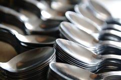 Teaspoon arranged symmetrically on the table. Stock Photos