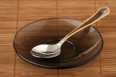 Teaspoon em um saucer Foto de Stock