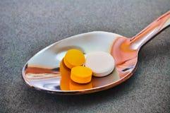 Teaspoon full of pills Royalty Free Stock Photo