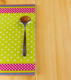 Teaspoon on green cutting board Stock Photos