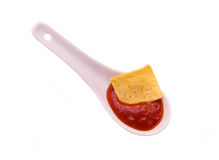 Teaspoon with hot sauce from above Stock Image