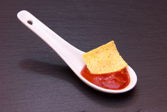 Teaspoon with hot sauce on slate Stock Photography