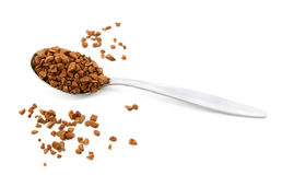 Teaspoon of instant coffee, some granules spilled Stock Photo